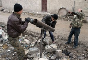 Opposition fighters prepare a homemade rocket-launcher during clashes with government forces near the airport on the outskirts of the northern Syrian city of Aleppo on January 27, 2104. Syrian peace talks in Geneva were deadlocked over the explosive issue of transferring power from President Bashar al-Assad's regime, delegates from the warring sides said. AFP PHOTO / AMC / ZEIN AL-RIFAI